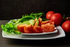 Chopped fresh vegetables decorated with spicy greens royalty free stock photo