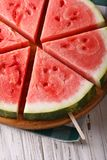 Chopped fresh watermelon on a stick close-up. vertical Royalty Free Stock Images