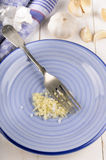 Chopped garlic and coarse salt on a plate Stock Photos