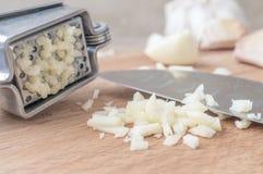 Chopped garlic or garlic press Stock Photography