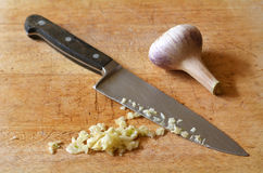 Chopped garlic on a wooden board Royalty Free Stock Photos