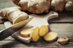 Chopped ginger root on cutting board Royalty Free Stock Photography