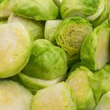 Green Brussel Sprouts. Chopped Green Brussel Sprouts Texture Closeup. Cabbage Background Top View Stock Photos