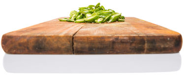 Chopped Green Chili Peppers On Chopping Board II stock photo