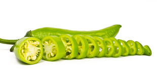 Chopped Green Chilli Peppers (Jalapeno). Hot green Jalapeno sliced and whole kept on white background Stock Image