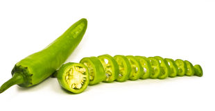 Chopped Green Chilli Peppers (Jalapeno). Hot green Jalapeno sliced and whole kept on white background Stock Photography
