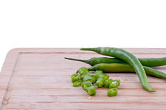 Chopped green chillies on chopping board Royalty Free Stock Photo
