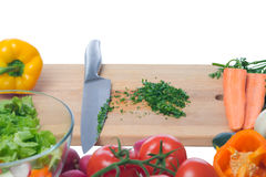 Chopped greens surrounded by fresh vegetables Stock Photography
