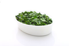 Chopped greens in a white bowl Royalty Free Stock Photo