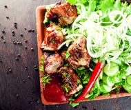 Chopped grilled roasted delicious steak meat lamb pork on a plat royalty free stock images
