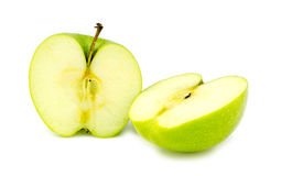 Chopped halves of fresh organic green granny smith apple. Detailed Stock Photography
