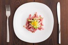 Chopped ham on white plate Stock Photo