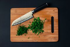Chopped herbs on board