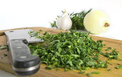 Chopped herbs on kitchen board Stock Photography