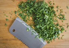 Chopped herbs on kitchen board Royalty Free Stock Photos