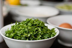 Chopped herbs in professional kitchen. Preparing food in professional kitchen Stock Image