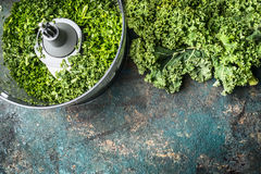 Chopped kale leaves on rustic background, top view Stock Images