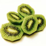 Chopped kiwi fruit. Some Chopped kiwi fruit on white plate stock photo