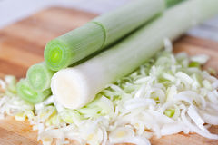 Chopped leek on a board, macro Stock Image