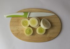 Chopped leek on a cutting board view. 