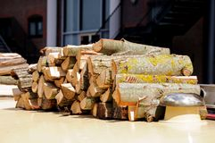 Chopped logs on narrowboat roof. Royalty Free Stock Image