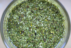 Chopped mate tea leaves. View looking into a glass with chopped , green yerba mate tea leaves.  Species:  Ilex paraguariensis Stock Photography