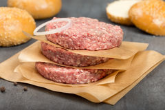 Chopped meat and the buns for hamburger Stock Photography