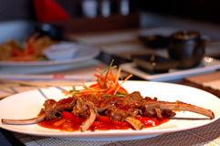 Chopped meat on a dish. The chopped meat on a dish at east restaurant stock photos