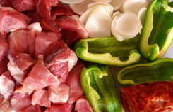 Raw meat and ingredients for spit. Chopped meat and ingredients for spit stock image