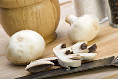 Chopped mushrooms on a cutting board. Some chopped mushrooms on a wooden cutting board stock images