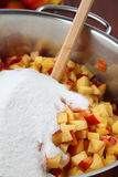 Chopped nectarines with sugar - making jam Stock Photo