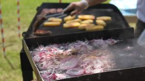 Chopped onion on hot plate and grill stock video footage