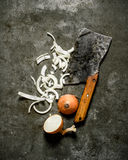 Chopped onion with an old hatchet. Stock Photos
