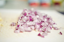 Chopped onion. Chopped red onion on a white board stock images