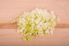 Chopped Onions and Garlic on Wood Cutting Board Stock Photography