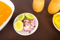 Chopped onions and lemon, side dish of fish soup Stock Photo