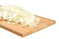 Chopped Onions On A Wooden Board Royalty Free Stock Image