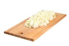 Chopped onions on a wooden board Stock Photography