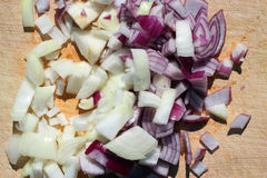 Chopped onions on a wooden board. Stock Photography