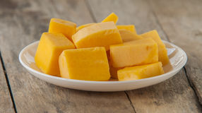 Chopped orange butternut squash on cutting board Royalty Free Stock Photo