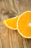 Chopped Oranges on wood Stock Images