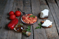 Chopped paprika. Red chopped paprika with tomatoes and cheese Royalty Free Stock Photography