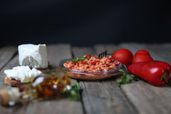 Chopped paprika. Red chopped paprika with tomatoes and cheese Stock Images