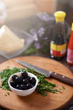 Chopped parsley on  board with olives Stock Photos