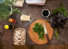 Chopped parsley on   board with other ingredients Royalty Free Stock Images