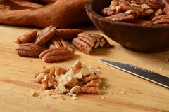 Chopped pecans. Close up of chopped pecans on a cutting board royalty free stock image