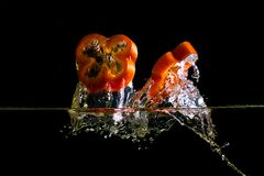 Chopped pepper and a splash of water Stock Image