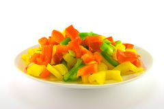 Chopped Peppers. Chopped assorted peppers on a white plate with a plain background Royalty Free Stock Photography