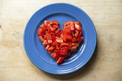 Chopped peppers in a heart shape Stock Photos
