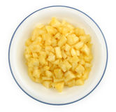 Chopped pineapple chunks in a white bowl Stock Photo